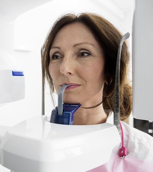 Woman receiving 3 D cone beam image scans